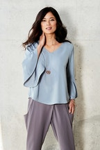 bird by design The V Neck Bell Sleeve Blouse